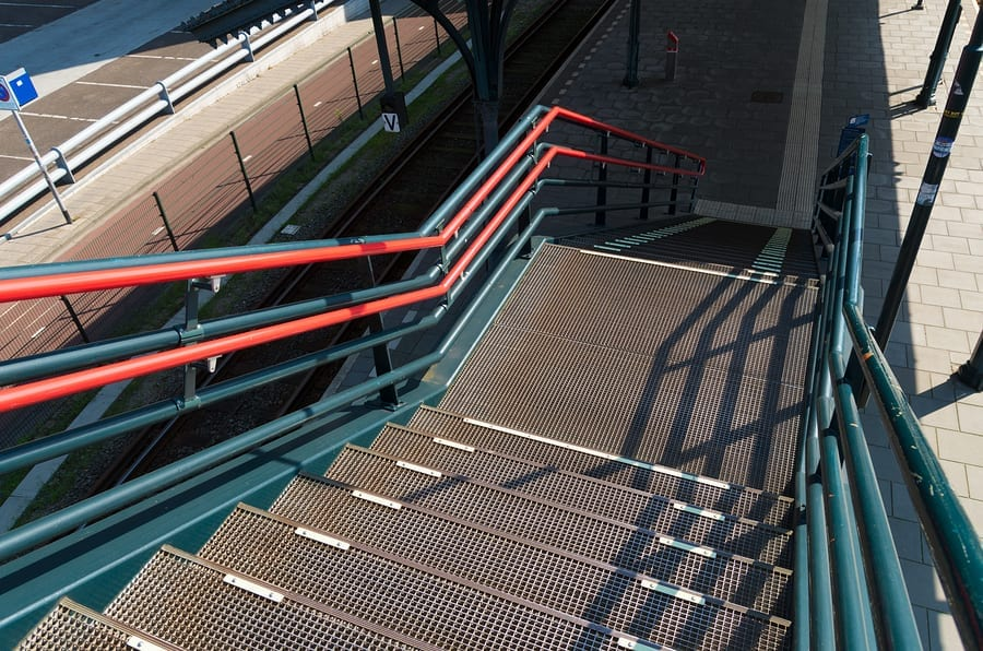 metal stairs leading down to a train platform