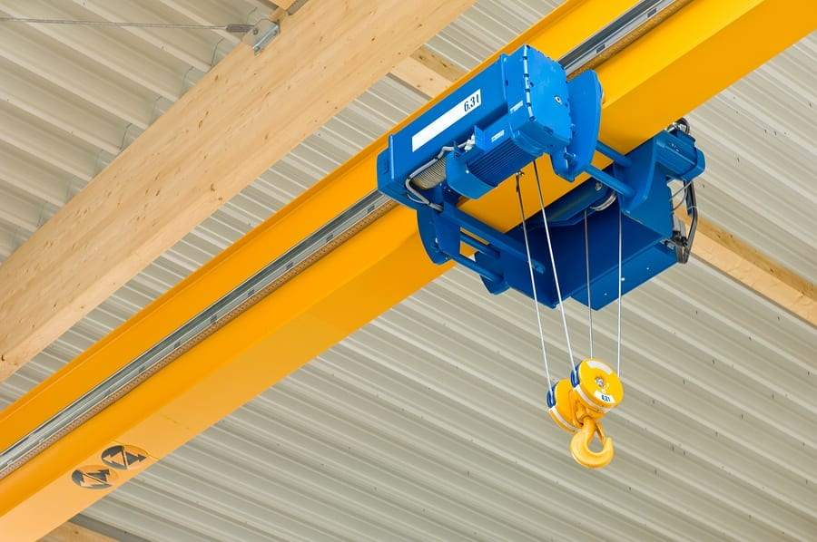 A blue overhead travveling crane in a construction hall